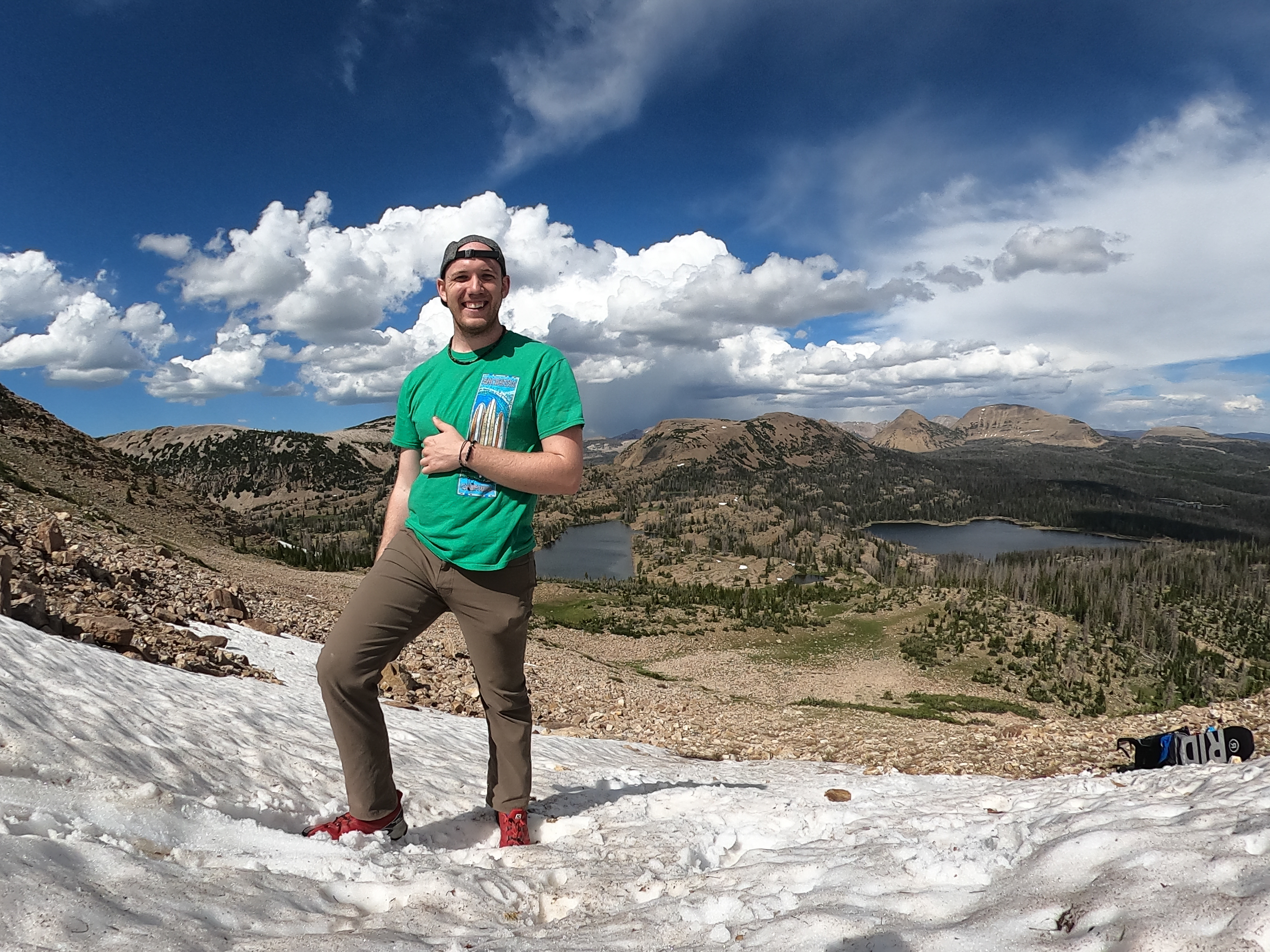 Trent standing on the glacier he plans to snowboard