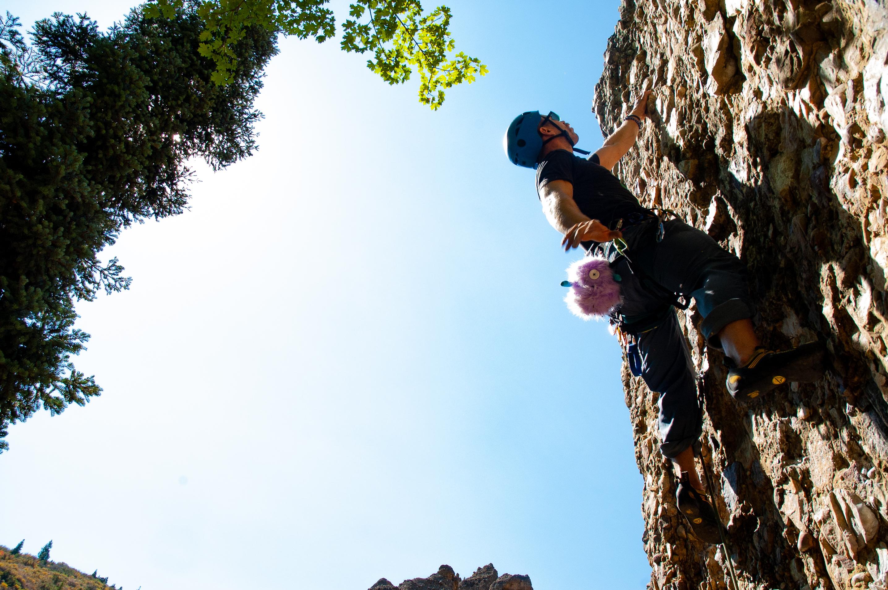 rock climber heading toward the sky