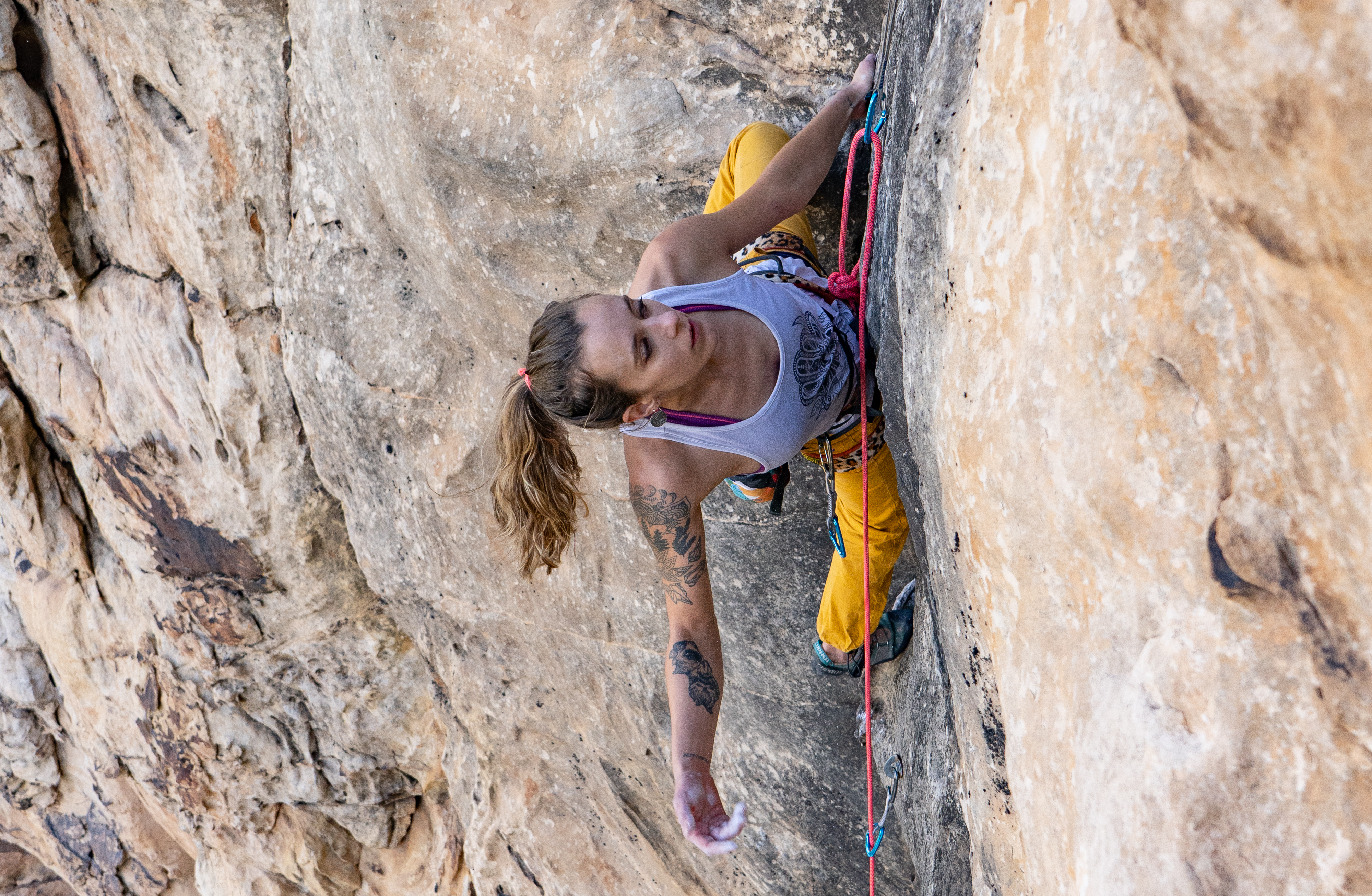 rock climber pauses for a rest and taking a breath on a climb