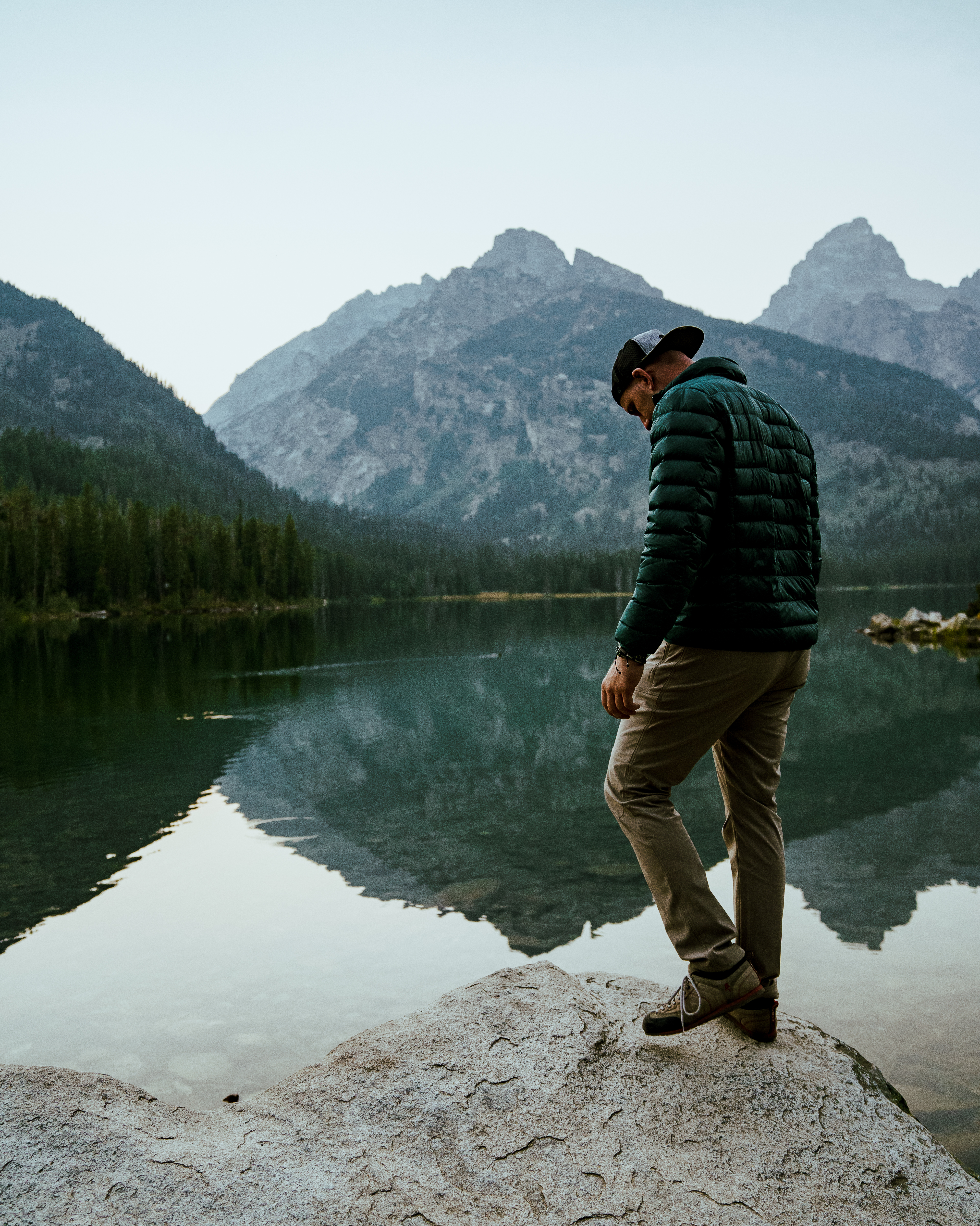 Hiker in front of Taggart lake, Teton National Park