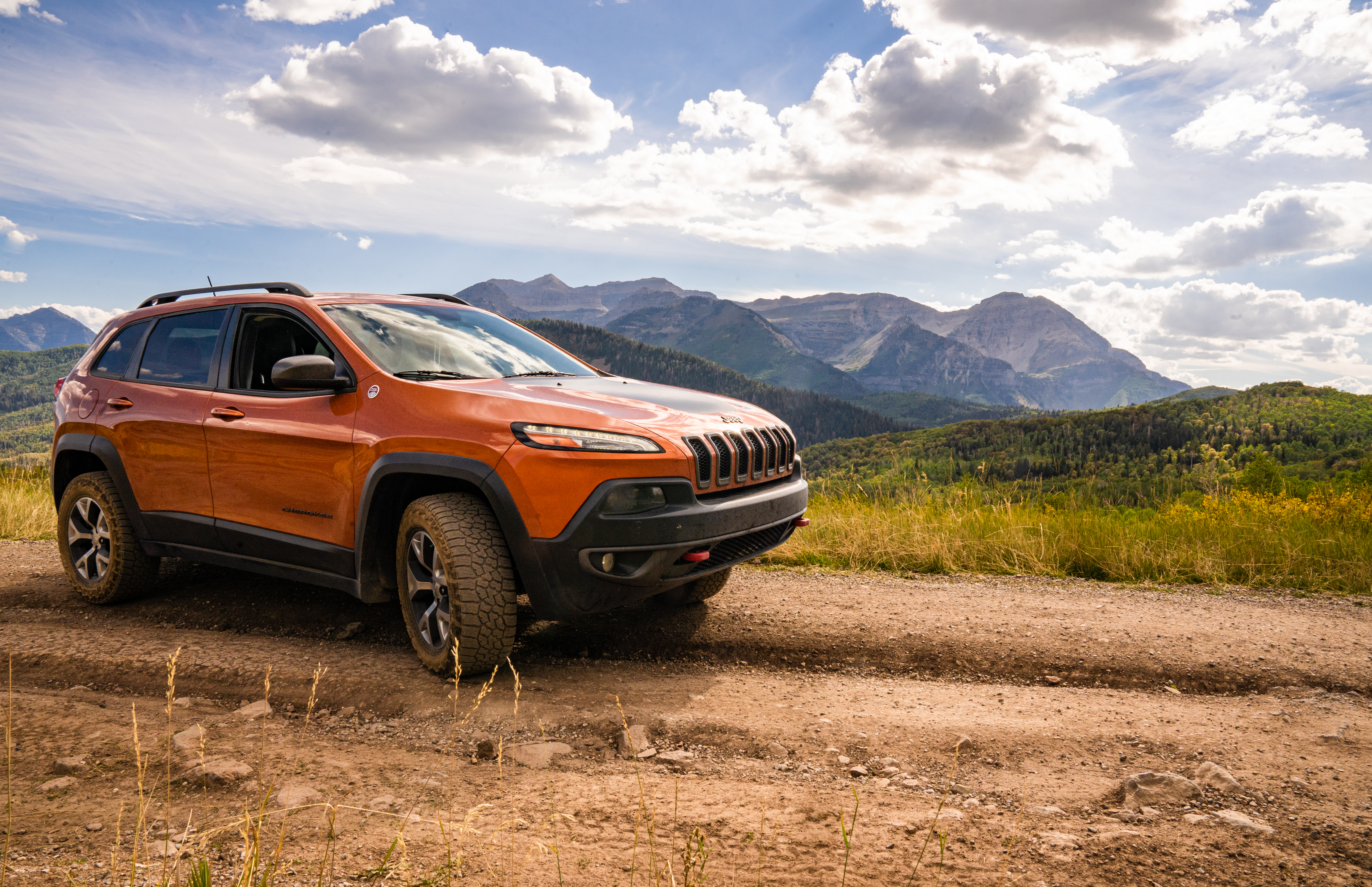 Jeep Cherokee Trailhawk on a dirt road in front of Mt timpanogos